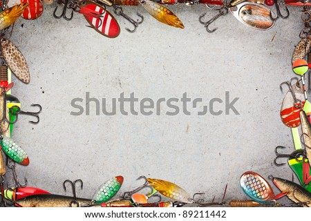 Frame with spinner lures and fishing floats. - stock photo