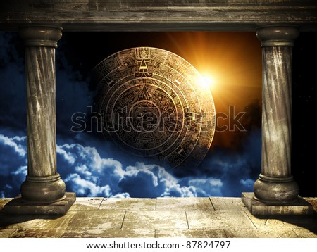 Frame with two old columns and Maya calendar - stock photo