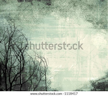 frame with wintry tree silhouettes and subtle lace pattern along the top - stock photo