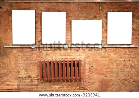frames on red brick wall - stock photo