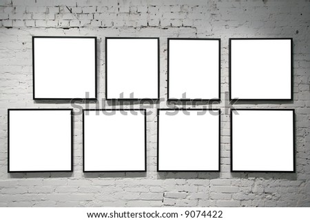 frames on white brick wall - stock photo