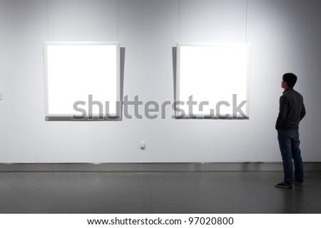 frames on white wall - stock photo