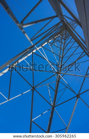 Frameword holding up overhead power lines for electricity. - stock photo
