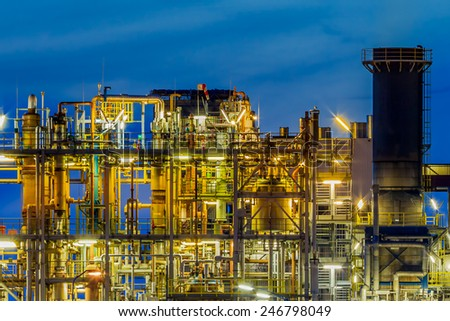 Framework detail in a heavy Chemical Industrial plant  with maze work of tubes and pipes during twilight - stock photo