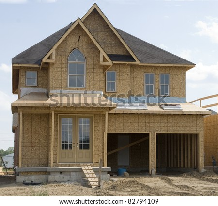 framework of a new house under construction - stock photo