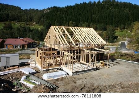 Framework of house under construction - stock photo