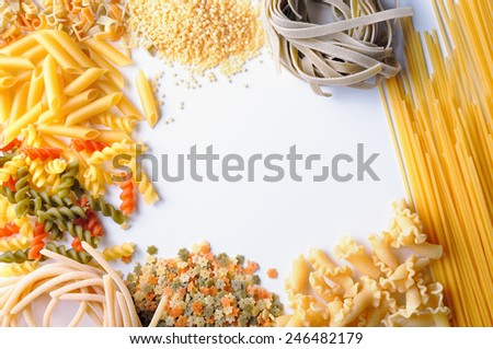framework of uncooked pasta isolated top view - stock photo