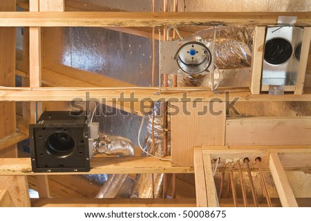 Framework showing the copper plumbing tubing and HVAC vents being installed. Horizontal shot. - stock photo