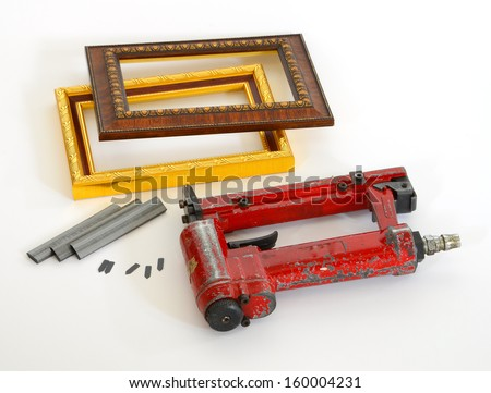 Framing tools. Put the gun fire wood wedge rear style on and off the frame and put on the white background.  - stock photo