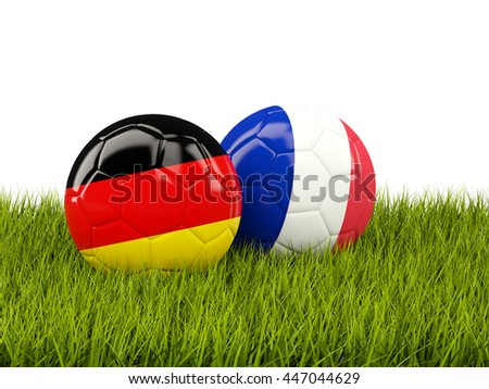 France and Germany soccer  balls on grass. 3D illustration - stock photo