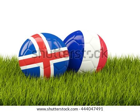 France and Iceland soccer  balls on grass. 3D illustration - stock photo