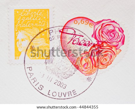 FRANCE - CIRCA 2003: A Heart Shaped Stamp showing pink and red roses on a white envelope, with another stamp and Paris postmark, circa 2003 - stock photo