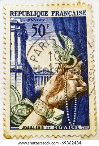 FRANCE - CIRCA 1938: A jewelry commemorative stamp printed in France shows wealthy woman's hand,  circa 1938 - stock photo