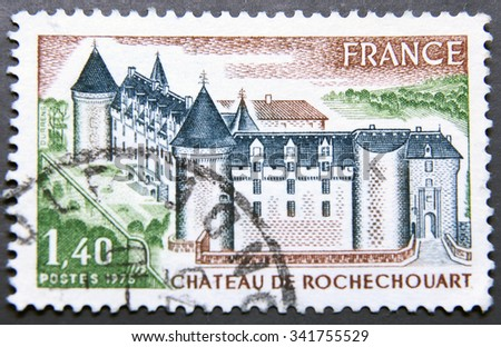 FRANCE - CIRCA 1975: A postage stamp of France shows Chateau de Rochechouart, located at the top of the confluence of the Grene and Vayres rivers - stock photo