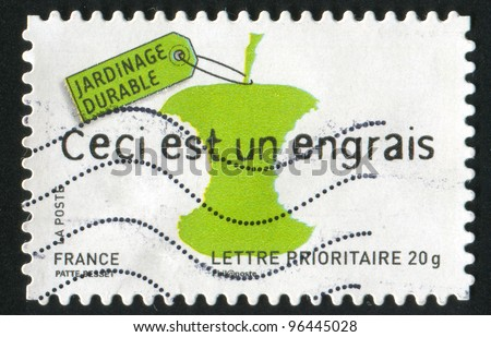 FRANCE - CIRCA 2008: A stamp printed by France, shows core of apple this is a fertilizer, circa 2008 - stock photo