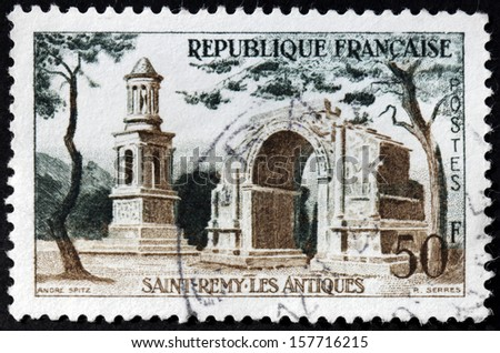 FRANCE - CIRCA 1957: A stamp printed by FRANCE shows image of the Roman ruins of Saint-Remy-de-Provence, circa 1957 - stock photo