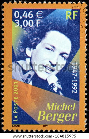 FRANCE - CIRCA 2001: A stamp printed by FRANCE shows image portrait of famous French pop singer and songwriter Michel Berger, circa 2001 - stock photo