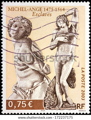 FRANCE - CIRCA 2003: A stamp printed by FRANCE shows Slaves sculptures (The Dying Slave and The Rebel Slave) by Italian sculptor Michelangelo, circa 2003