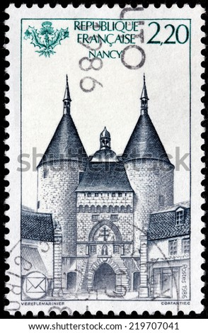 FRANCE - CIRCA 1986: A stamp printed by FRANCE shows view of the impressive Craffe Gate in Nancy, France, circa 1986 - stock photo
