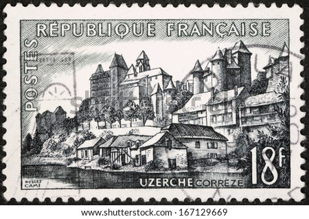 FRANCE - CIRCA 1956: A stamp printed by FRANCE shows view of Uzerche town in the Correze department - The Vezere river, the Castle, and the Abbey Church, circa 1956.