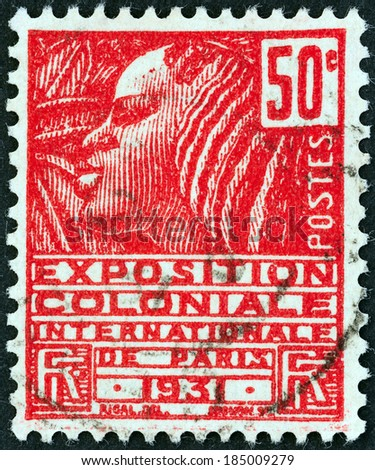 """FRANCE - CIRCA 1930: A stamp printed in France from the """"International Colonial Exhibition """" issue shows Woman of the Fachi tribe, circa 1930.  - stock photo"""