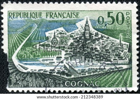 """FRANCE - CIRCA 1961: A stamp printed in France from the """"Tourist Publicity"""" issue shows Cognac town, circa 1961. - stock photo"""