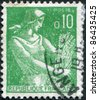 FRANCE - CIRCA 1960: A stamp printed in France, shows a Farm Woman, circa 1960 - stock photo