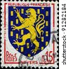 FRANCE - CIRCA 1960: A stamp printed in France shows coat of arms of Nevers - the administrative capital of the Nievre department in the Bourgogne region in central France, circa 1960 - stock photo