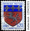 "FRANCE - CIRCA 1966:A stamp printed in France shows coat of arms of Saint-Lo (capital of Manche department in Normandy) in France, with the same inscriptions, series ""Arms of French Towns"", circa 1966 - stock photo"