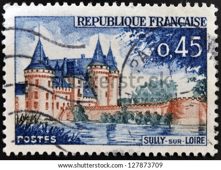 FRANCE - CIRCA 1961: A stamp printed in France shows image of Sully-sur-Loire castle, the historic seat of the ducs de Sully, circa 1961 - stock photo