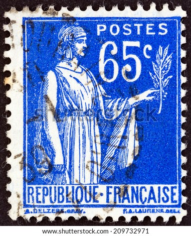 FRANCE - CIRCA 1937: A stamp printed in France shows Peace allegory, circa 1937.  - stock photo