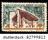 FRANCE - CIRCA 1964: A stamp printed in France shows The chapel Notre Dame du Haut - Ronchamp, circa 1964 - stock photo