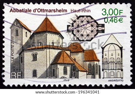 FRANCE - CIRCA 2000: a stamp printed in the France shows Abbey Church of Ottmarsheim, Alsace, circa 2000 - stock photo