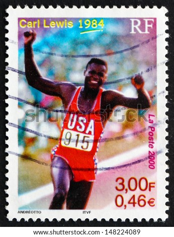 FRANCE - CIRCA 2000: a stamp printed in the France shows Carl Lewis Wins Four Olympic Gold Medals, 1984, circa 2000 - stock photo