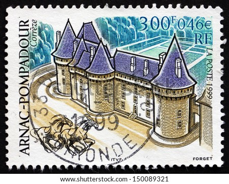 FRANCE - CIRCA 1999: a stamp printed in the France shows Chateau Arnac-Pompadour, Limousin Region, circa 1999 - stock photo