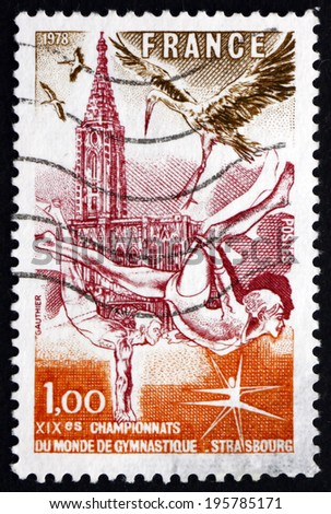 FRANCE - CIRCA 1978: a stamp printed in the France shows Gymnasts, Strasbourg Cathedral and Storks, 19th World Gymnastics Championships, Strasbourg, circa 1978 - stock photo