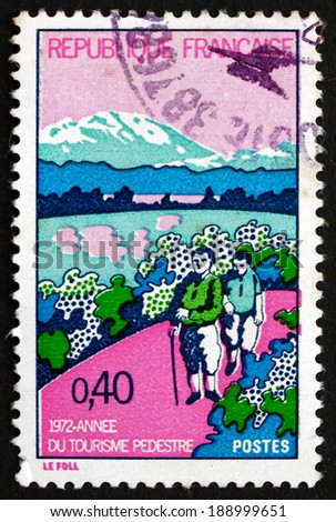 FRANCE - CIRCA 1972: a stamp printed in the France shows Hikers and Mt. Aigoual, International Year of Tourism and 25th Anniversary of the National Hikers Association, circa 1972 - stock photo