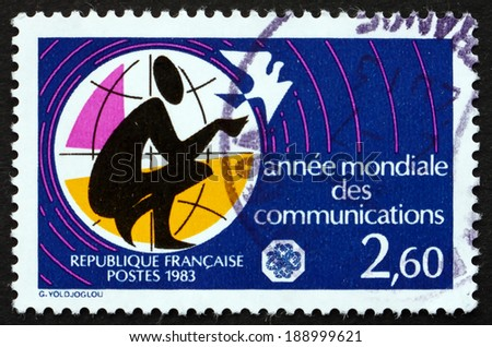 FRANCE - CIRCA 1983: a stamp printed in the France shows Man with Dove, World Communications Year, circa 1983 - stock photo
