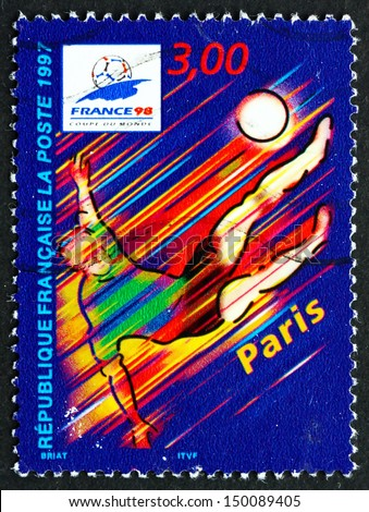 FRANCE - CIRCA 1997: a stamp printed in the France shows Paris, Host City of 1998 World Cup Soccer Championships, Stylized Action Scene, circa 1997 - stock photo