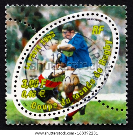 FRANCE - CIRCA 1999: a stamp printed in the France shows Rugby Scene, 1999 Rugby World Cup, Cardiff, Wales, circa 1999 - stock photo