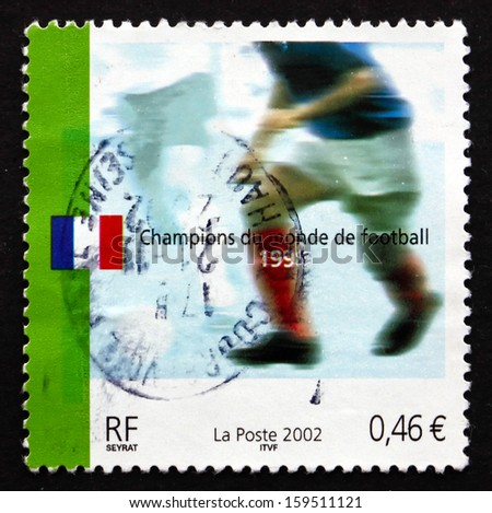 FRANCE - CIRCA 2002: a stamp printed in the France shows Soccer Player, 2002 World Cup Soccer Championships, Japan and Korea, circa 2002 - stock photo