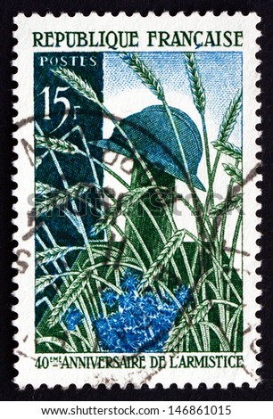 FRANCE - CIRCA 1958: a stamp printed in the France shows Soldier'??s Grave in Wheat Field, 40th Anniversary of the World War I Armistice, circa 1958 - stock photo