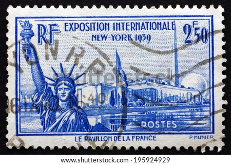 FRANCE - CIRCA 1939: a stamp printed in the France shows Statue of Liberty, French Pavilion, Trylon and Perisphere, New York World's Fair, circa 1939 - stock photo