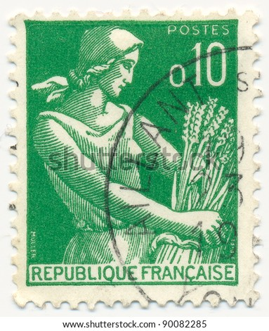 FRANCE - CIRCA 1959: stamp printed by France, shows peasant woman with sheaf, circa 1959 - stock photo