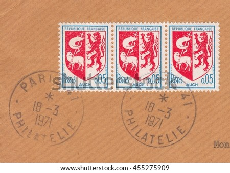 FRANCE-CIRCA 1971: stamp printed by old postcard France,shows Standard postage stamp depicting coat of arms of the city Auch on the old postal envelope,circa 1971 - stock photo