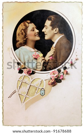 FRANCE - CIRCA 1913: Vintage postcard with hand-tinted photograph of man and woman in romantic pose. Circa 1913. - stock photo