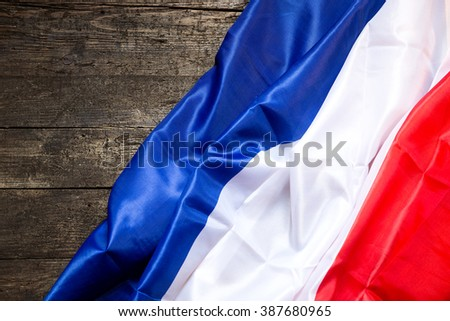 France Flag on a vintage wooden Table