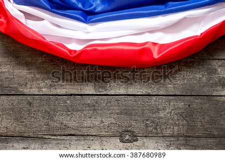 France Flag on a wooden table, copyspace