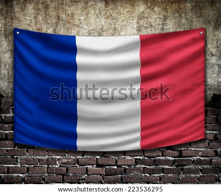 france flag on old wall - stock photo