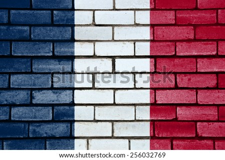 France flag painted on old brick wall texture background - stock photo